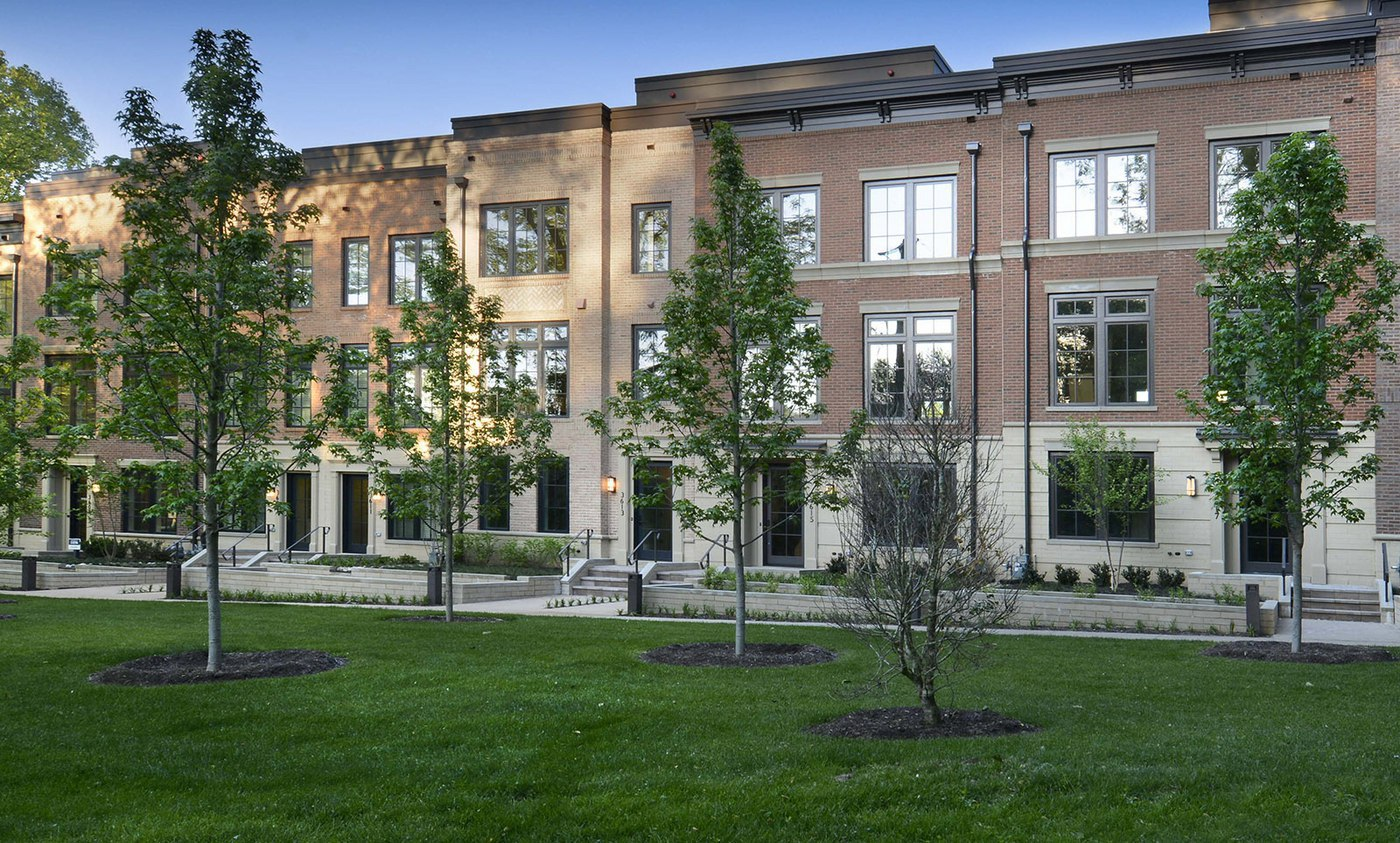 Classic brick exteriors and fine architectural detail with modern expansive windows in luxury homes for sale photo