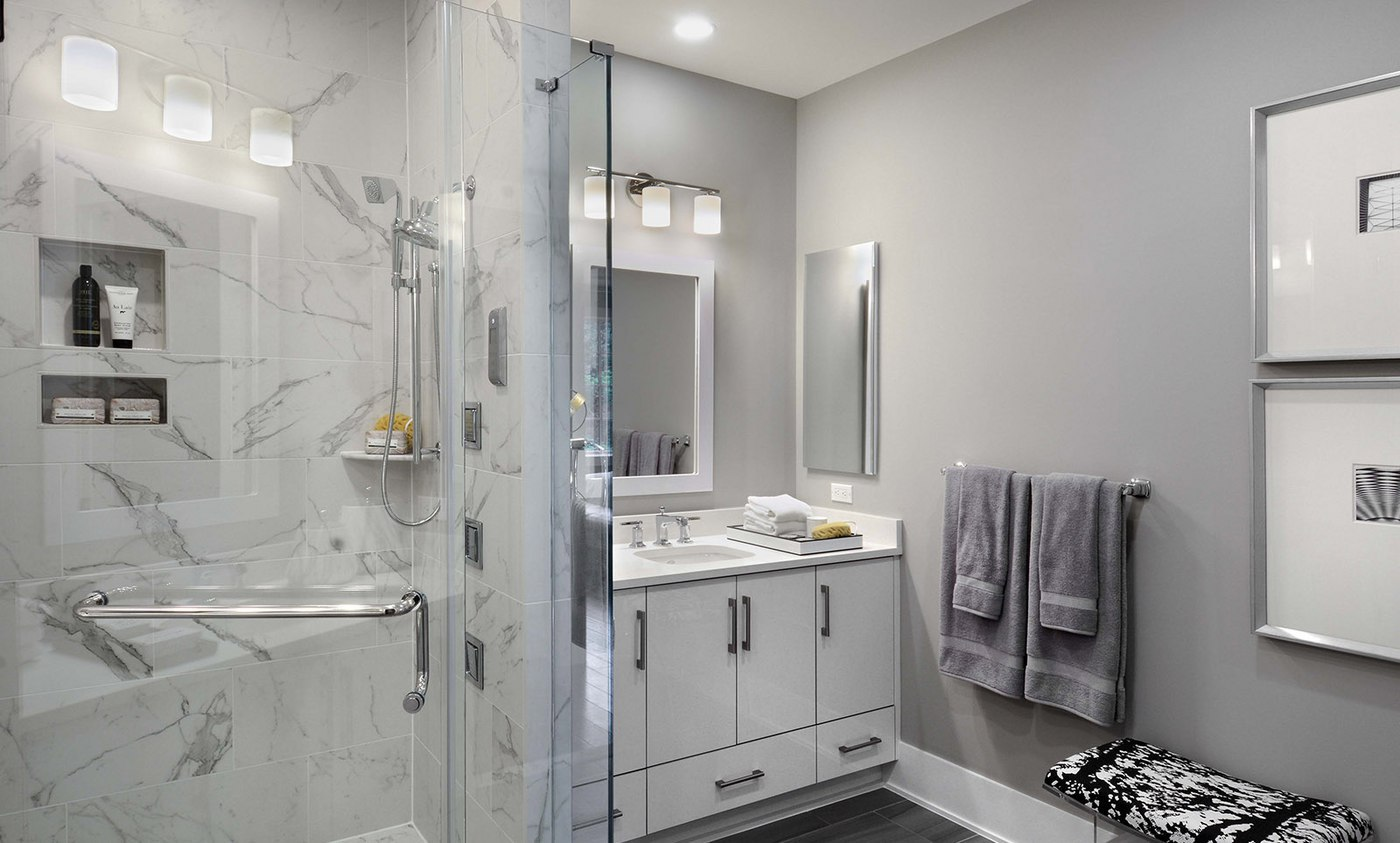 Owners' bath features contemporary design with finishes in our luxury homes for sale